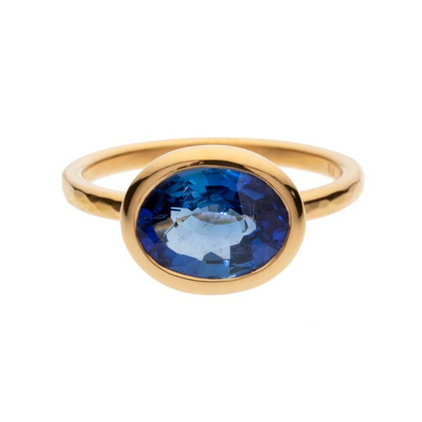 A Madagascan oval sapphire weighing 3.53 carats set in a 22 carat gold ring.