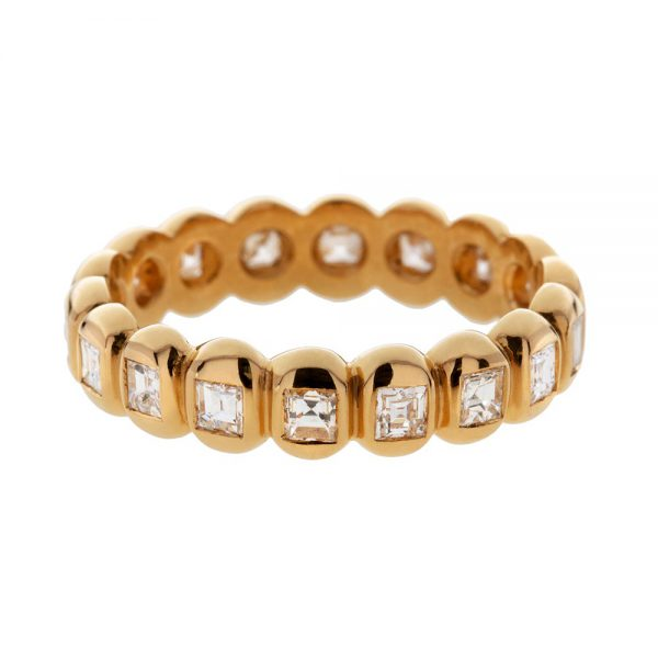 White carré cut diamonds weighing 1.03 carats set in an eternity ring in 22 carat gold